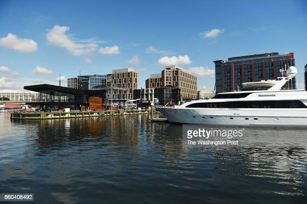 Luxurious motor yachts some available for charter are seen in front of the newly developed Wharf in Washington DC October 10 near the dock from which...