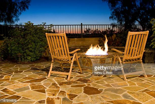 luxurious outdoor fire pit with seating to view the sunset - paving stone stock pictures, royalty-free photos & images