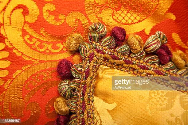 luxurious red and gold pillows with beautiful tasselss - tassel stock pictures, royalty-free photos & images