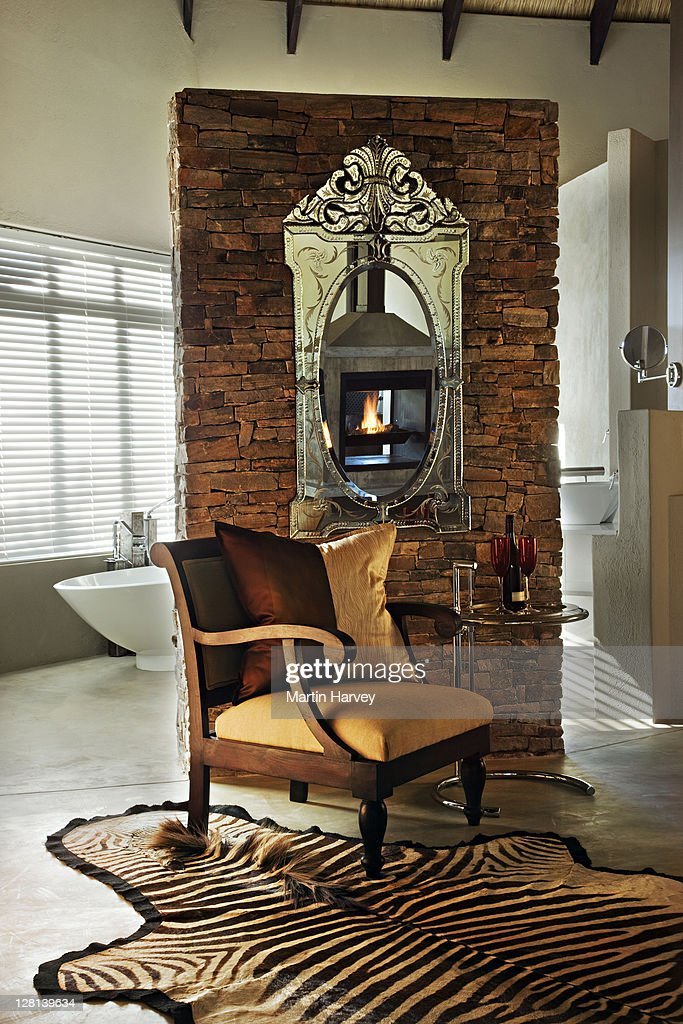 Luxurious suite decorated in ethnic style with European elegance. Chitwa Chitwa Private Game Lodge, situated in the world famous Sabi Sand Game Reserve, bordering the Kruger National Park. South Africa (PR: Property Released) : Bildbanksbilder