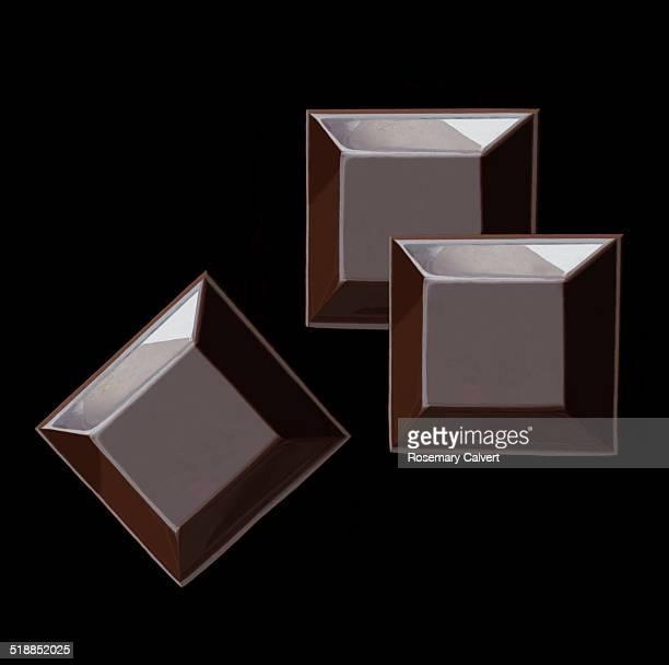 Luxurious treat, dark chocolate squares on black