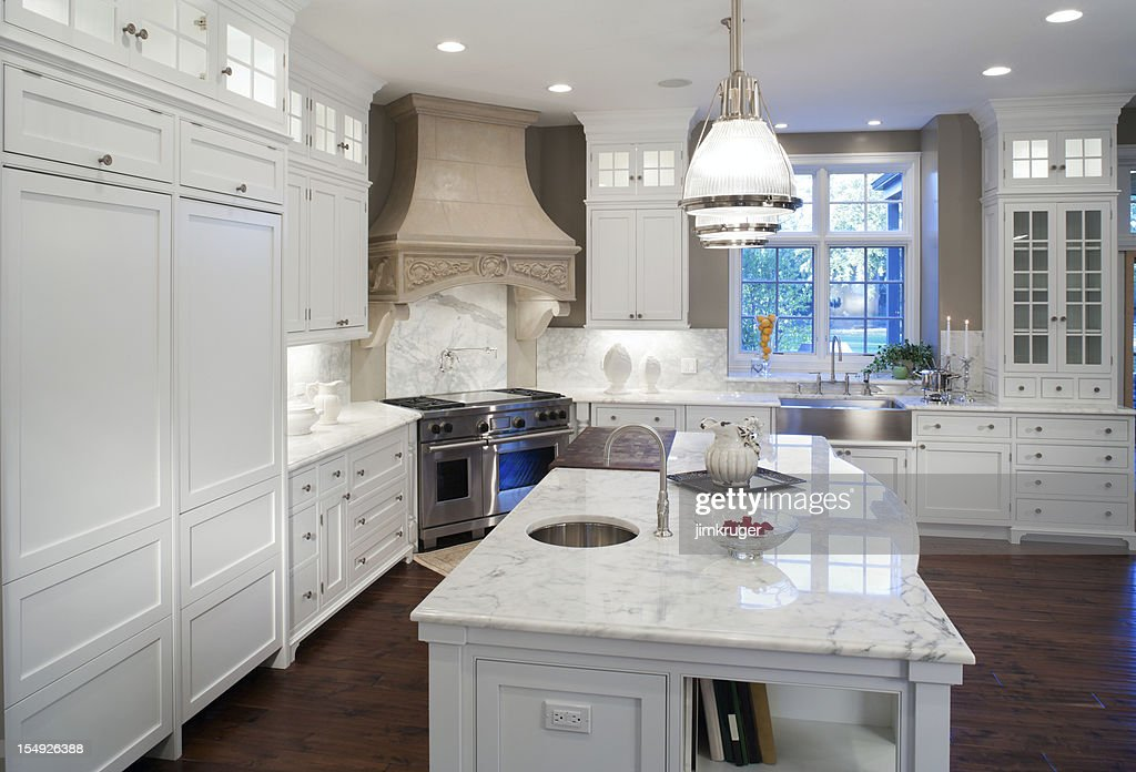 Luxurious white marble residential kitchen. : Stock Photo