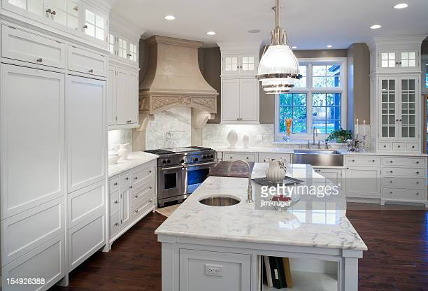 Luxurious white marble residential kitchen.