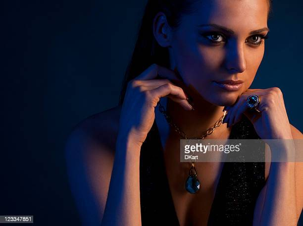 luxurious, young, dark-haired woman in expensive jewelry - topaz stock photos and pictures