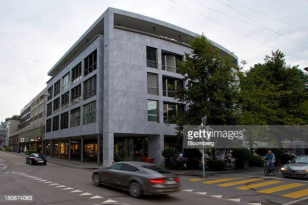 Luxury automobiles are driven past the building that houses the headquarters of Xstrata Plc in Zug, Switzerland, on Friday, Aug. 24, 2012. Glencore's...