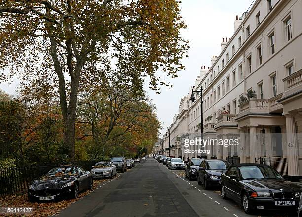 Luxury automobiles are seen parked alongside residential property on Eaton Place in the London area of Belgravia in London UK on Thursday Nov 15 2012...