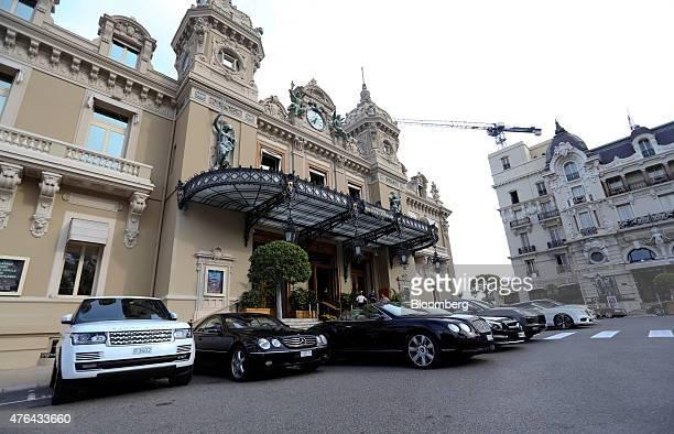 Luxury automobiles including a Range Rover MercedesBenz Bentley and a Porsche stand outside the Casino de MonteCarlo in Monaco on Monday June 8 2015...