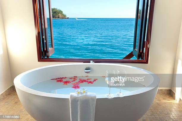 luxury bathroom at over water resort - fiji stock pictures, royalty-free photos & images
