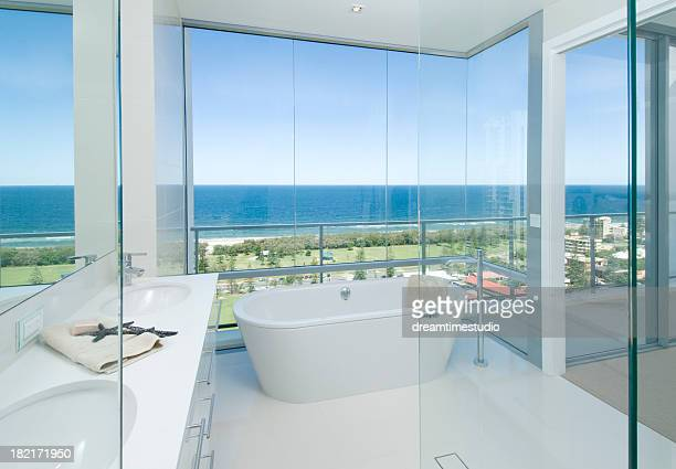Luxury bathroom in white with glass