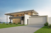 Luxury beach house with sea view swimming pool and big garage in modern design. Empty green grass lawn at vacation home.