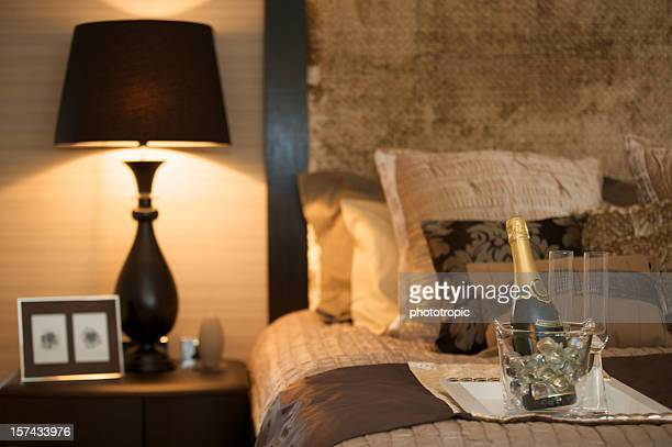 luxury bedroom with champagne - gold meets golden stock photos and pictures