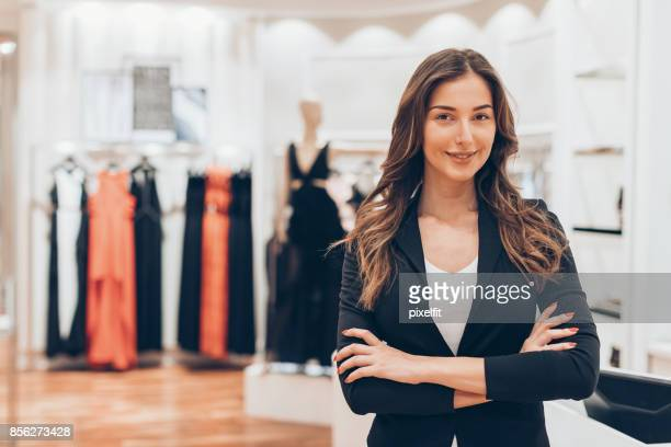 luxury boutique owner - saleswoman stock photos and pictures