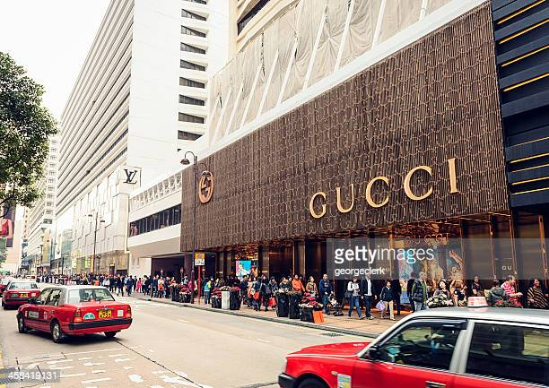 luxury brands in hong kong - tsim sha tsui stock pictures, royalty-free photos & images