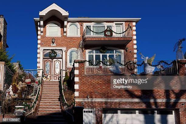 luxury brooklyn house with christmas decorations, new york. blue sky. - dyker heights stock pictures, royalty-free photos & images