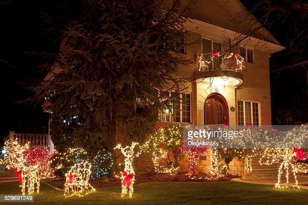 luxury brooklyn house with christmas lights at night, new york. - dyker heights stock pictures, royalty-free photos & images
