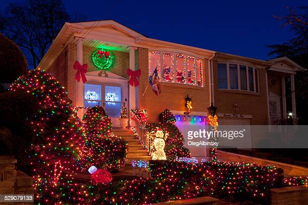 luxury brooklyn house with christmas lights at sunset, new york. - dyker heights stock pictures, royalty-free photos & images