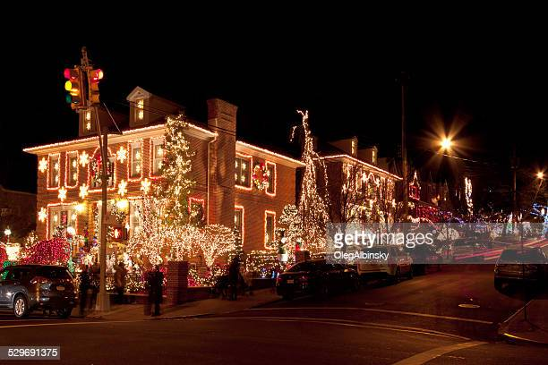 luxury brooklyn houses with christmas lights at night, new york. - dyker heights stock pictures, royalty-free photos & images