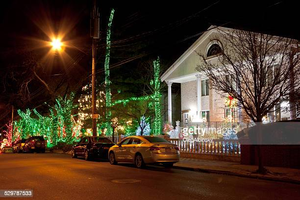 luxury brooklyn houses with christmas lights at sunset, new york. - dyker heights stock pictures, royalty-free photos & images
