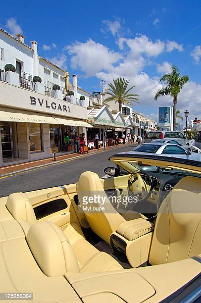 Luxury car and shops at the exclusive yacht harbour of Puerto Banœs, Marbella, Costa del Sol. Malaga province, Andalusia, Spain