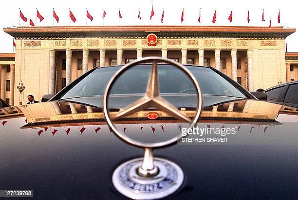 A luxury car driven by a Chinese official is parked in front of the Great Hall of the People during a session of the National People's Congress at...