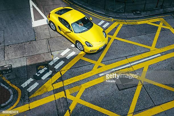 luxury car in hong kong, china - travessia de pedestres marca de rua - fotografias e filmes do acervo