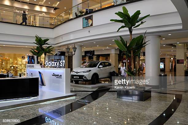 A luxury car to be won promoted by Samsung mobile Galaxy S7 under the watchful eyes of Iran's leaders poster in the newly opened Palladium shopping...