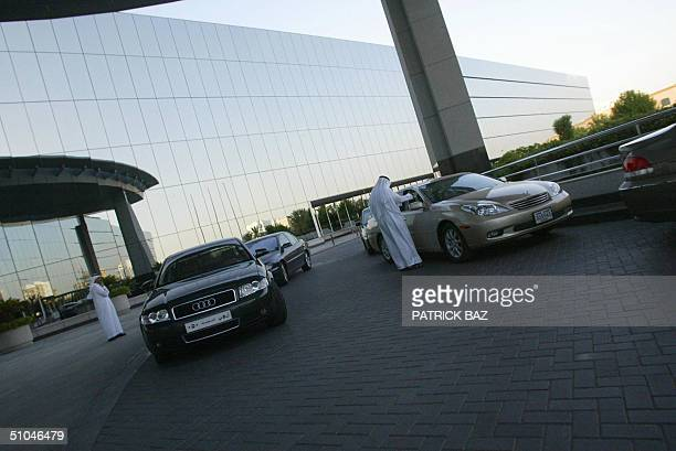 Luxury cars are seen parked in front of the Kingdom Tower 10 July 2004 a landmark of Riyadh owned by Saudi Prince Waleed bin Talal Saudi Arabia...