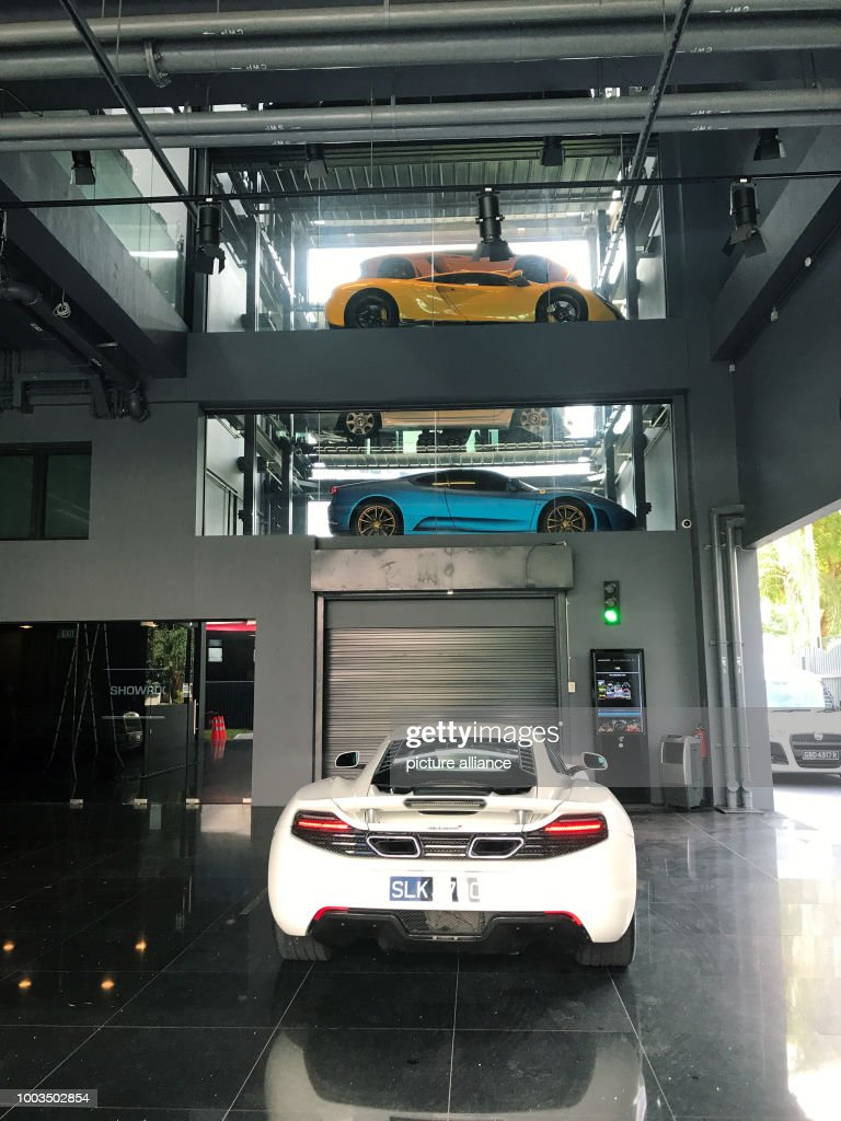 Luxury Cars Stacked In A New 15 Storey Car Vending Machine In