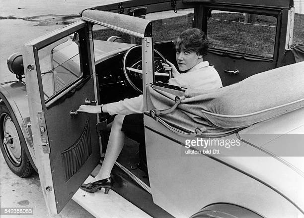 Luxury cars Young woman sitting in a Brennabor cabriolet with the top down the door frame stays upright 1928 Photographer Hans Henschke Vintage...