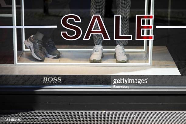 Luxury casual footwear in a window display at a Hugo Boss AG store in Berlin, Germany, on Wednesday, Aug. 4, 2021. Hugo Boss is confident that the...