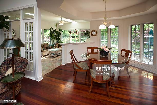 Luxury Casual Open-Concept Design Dining Room With Adjoining Sunroom