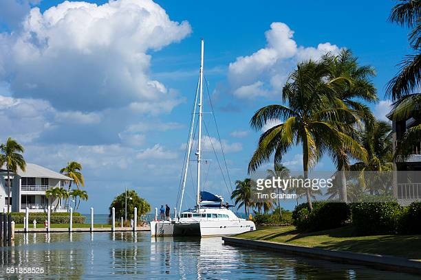 Luxury catamaran yacht sailing into port at upmarket South Seas Island Resort on Captiva Island in Florida USA