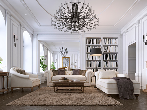 Luxury classic interior of living room and dining room with white furniture and metal chandeliers. 1085075038