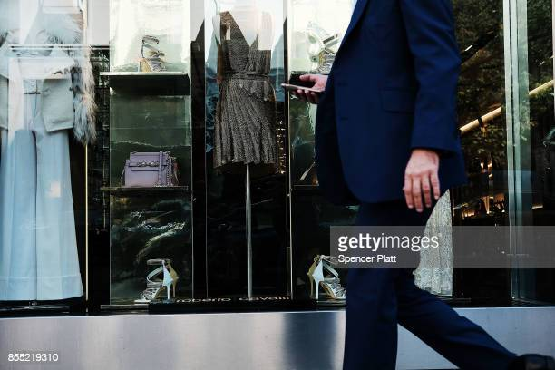 Luxury clothing is displayed in a window along Madison Avenue one of the most expensive shopping districts in America on September 28 2017 in New...