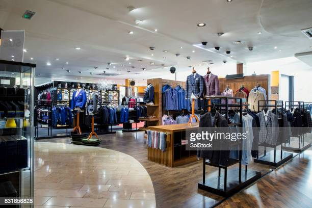 luxury clothing store for men - shopping mall stock pictures, royalty-free photos & images