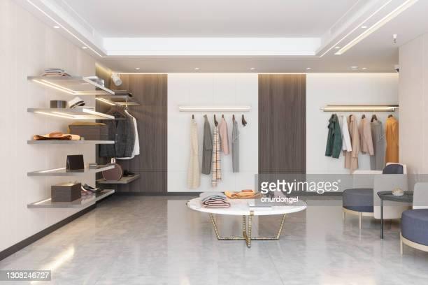 lyxig klädbutik med kläder, skor och andra personliga accessoarer. - modekollektion bildbanksfoton och bilder
