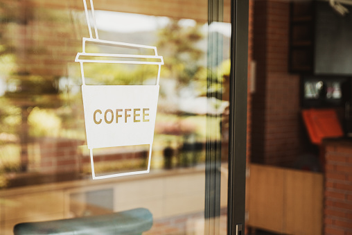 Luxury coffee shop sign on the glass door. For art texture or web design backgrund. 1030151188