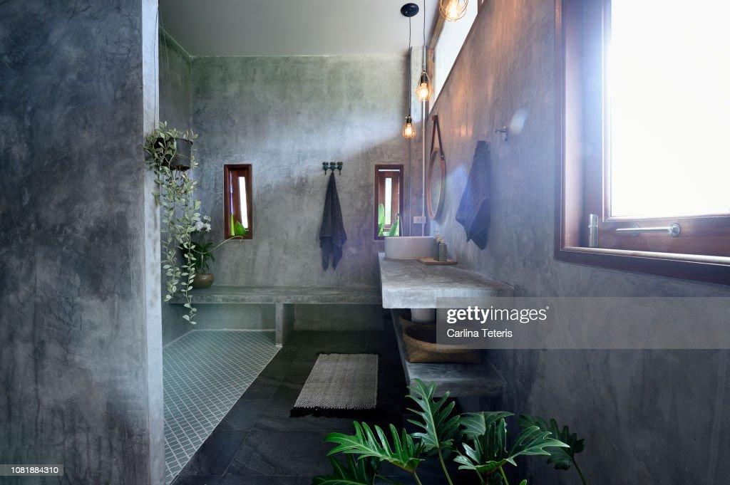Luxury concrete and tile bathroom : Stock Photo