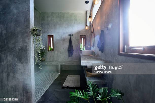 luxury concrete and tile bathroom - bathroom stock photos and pictures