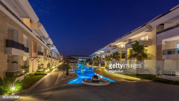 Luxury Construction hotel with Swimming Pool at sunset