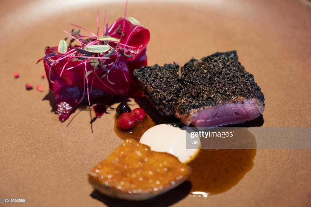 Luxury Cuisine, Main Course, roast ostrich meat,fried foie gras beetroot : Stock Photo