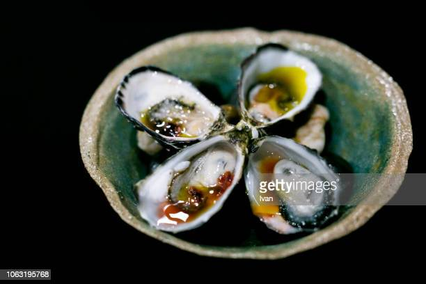luxury cuisine, oysters with sauce in blackground - cancale photos et images de collection