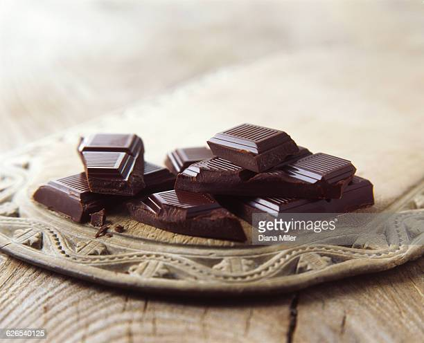 luxury dark chocolate broken on vintage wooden board - dark chocolate stock pictures, royalty-free photos & images