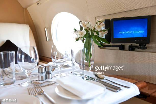 a luxury dinner for two onboard a jet. - air vehicle stock pictures, royalty-free photos & images
