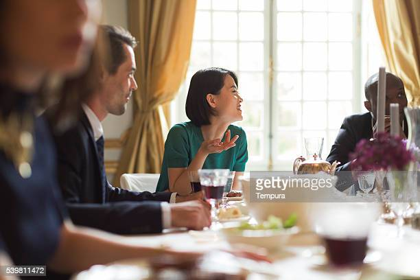 luxury dinner, friends eating together - high society stock photos and pictures