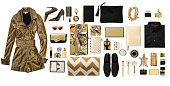 Luxury fashionable gold clothing and stationery items flat lay on white background