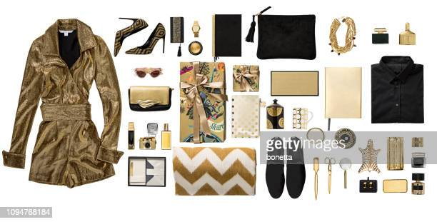 luxury fashionable gold clothing and stationery items flat lay on white background - cut out dress stock pictures, royalty-free photos & images