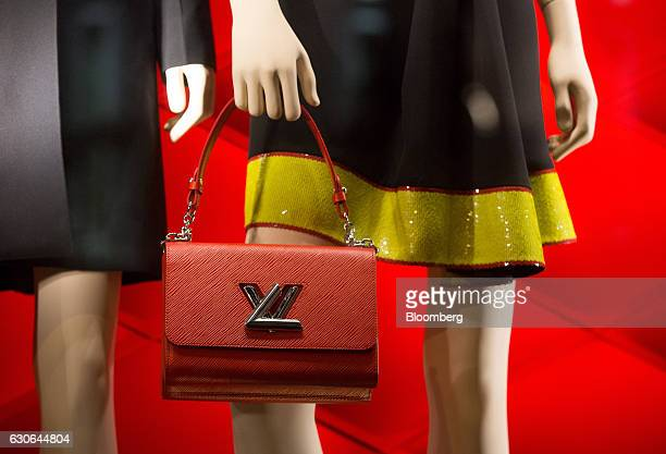 12f32811e08c Luxury fashions and accessories sit on display at the Louis Vuitton  boutique operated by LVMH Moet