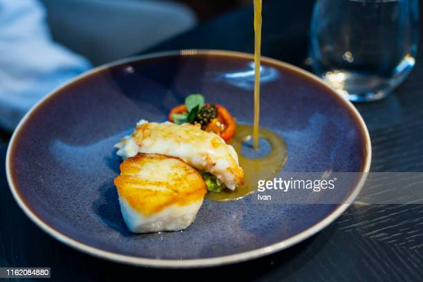 luxury fine dining, fried scallops, black caviar and shrimp - cross processed stock pictures, royalty-free photos & images