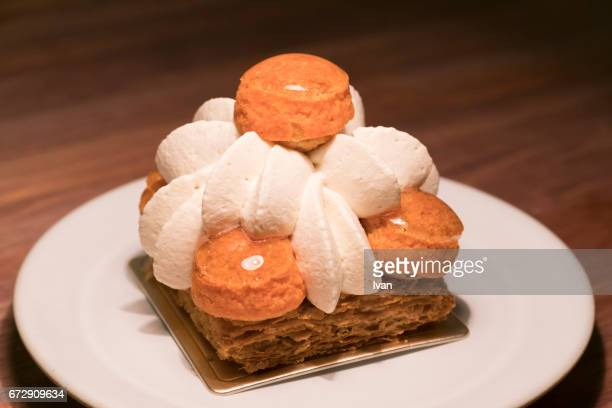 Luxury French Dessert, Vanilla Caramel Puffs with Napoleon Slice (mille-feuille) and Cream